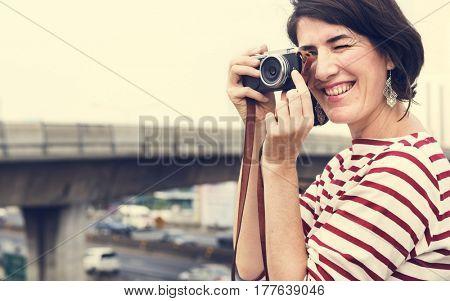 Woman traveler photographer holiday lifestyle trip