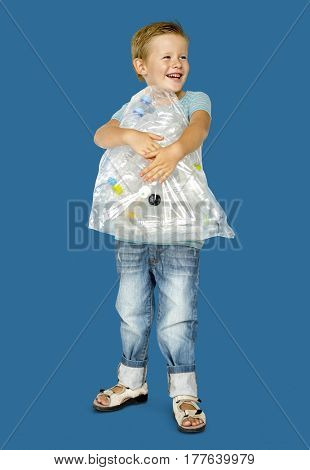 Caucasian Ethnicity Boy holding Bag with Plastic Bottles