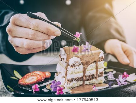 chef chocolate pastry dessert flower plate fine garnish icing making cake cooking