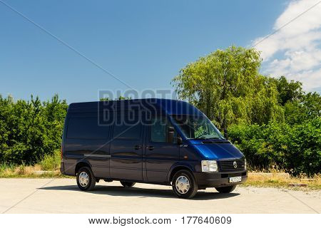 OLEKSANDRIVKA DNIPROPETROVSK REGION UKRAINE - JUNE 16 2015: VOLKSWAGEN LT TRUCK BLUE COLOR NEAR THE SAMARA RIVER IN DNIPROPETROVSK REGION SUMMER TIME