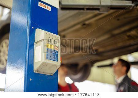 Car lift at car mechanic modern garage