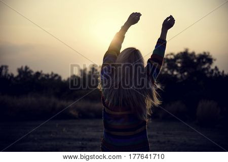 Young Adult Woman Stretching Arms in the Morning Relaxation