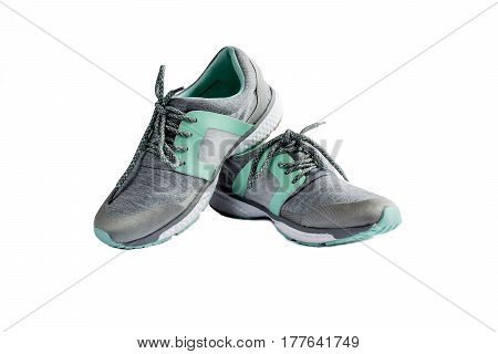 sport women's running shoes gray on a white background isolated