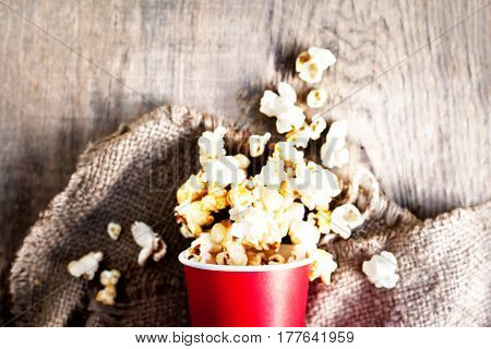 Homemade Kettle Corn Popcorn on wooden rustic table with copy space