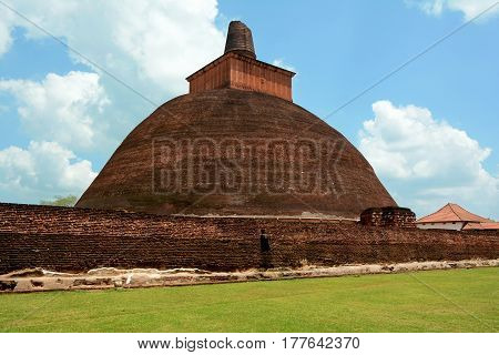 Old bricky Jetavaranama dagoba located in the ruins of Jetavana Monastery in the ancient city Anuradhapura Sri Lanka