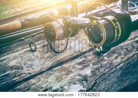 fishing rod gear background spinning wheel reel angler bait concept