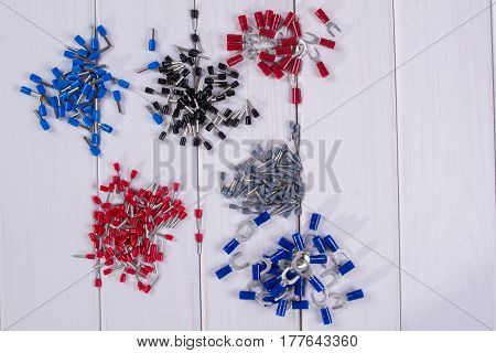 Cable lug in different colors and sizes on a white background