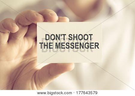 Businessman Holding Dont Shoot The Messenger Message Card
