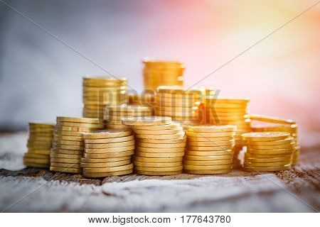 golden coin money stack save savings profit wooden table