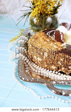 Holiday meal concept. Sweet chocolate cake with peanuts shredded coconut flakes and tea.