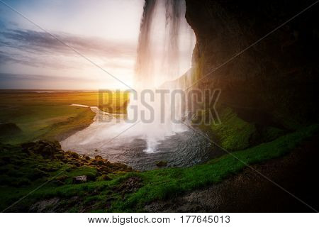 Perfect view of famous powerful Seljalandsfoss waterfall in sunlight. Dramatic and gorgeous scene. Popular tourist attraction. Location place Iceland, sightseeing Europe. Discover the world of beauty