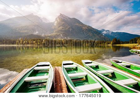Famous Hintersee lake with of the wooden pier at sunny day. Picturesque scene. Location resort Ramsau, National park Berchtesgadener Land, Upper Bavaria, Germany Alps, Europe. World of beauty.