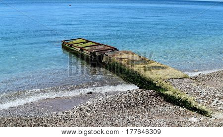 Old vintage dock for fishing boats at sea