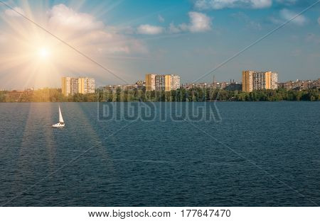 Residential many storeys houses near the river city dnepr nature background