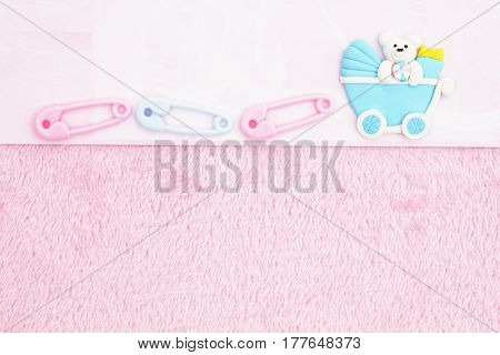 Old fashion pink baby background with baby diaper pins and a baby carriage