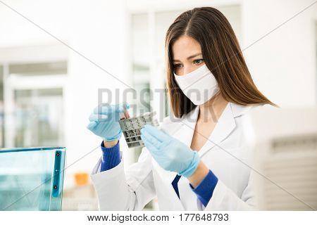 Female Chemist Analyzing Some Blood