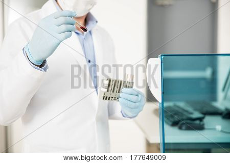 Chemist Running Blood Tests In A Lab