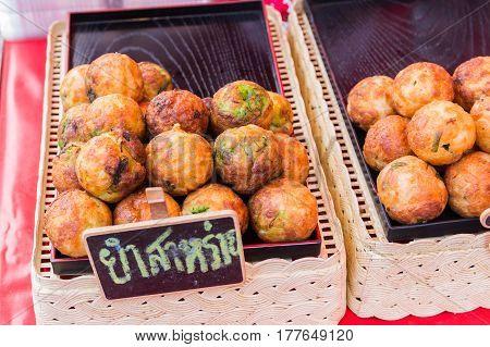 Takoyaki in pan on the market background