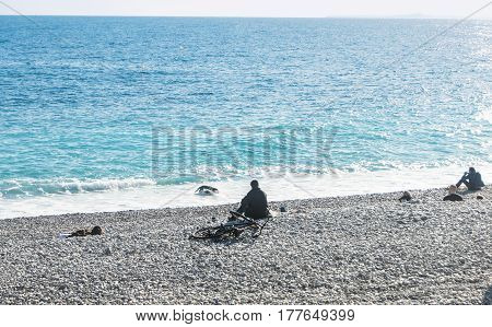 Nice, France - 25 February, People are resting by the water, 25 February, 2017. People and tourists having a rest on the Cote d'Azur.