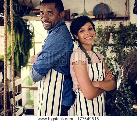 African Descent Owner Couple Stand Inside Flower Shop