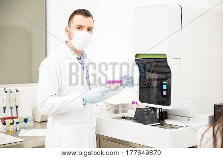 Hispanic Male Chemist Working In A Lab