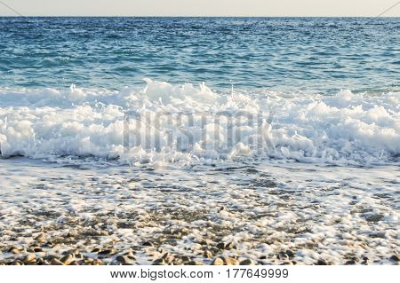 Foam settling on the shore. View of the Côte d'Azur in Nice.
