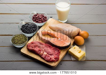 Different types of proteins on wood background