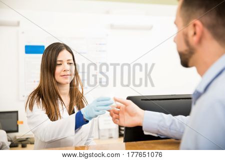 Receptionist Receiving Urine Sample