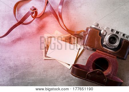 Old vintage photos and old camera on concrete background
