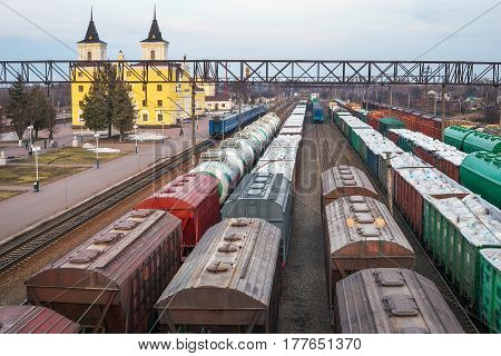 Freight wagons at the station. Rail transportation. Freight. A train carrying wood timber. Trade blockade