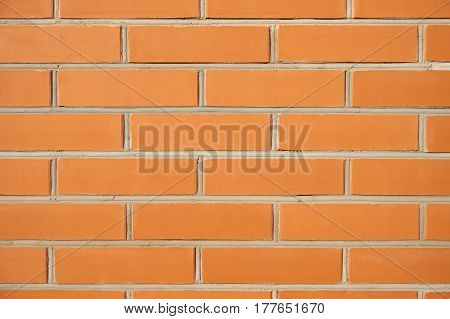 Red brick wall exterior as seamless background