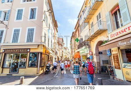 Antibes, France - June 27, 2016: day view of main street Rue de la Republique with tourists in Antibes France. Antibes is a popular seaside town in the heart of the Cote d'Azur.