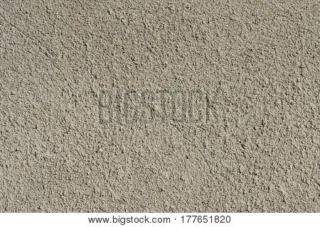 Gray cement structered finishing on the foundation of the house