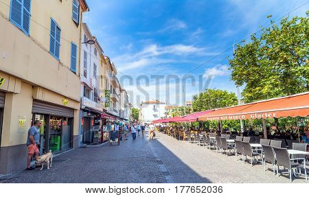 Antibes, France - June 27, 2016: day view of Place des Martyrs de la Resistance with tourists in Antibes France. Antibes is a popular seaside town in the heart of the Cote d'Azur.
