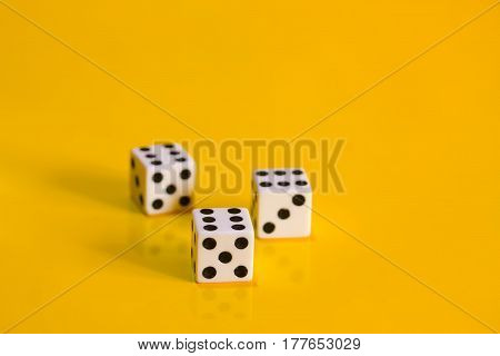 Three simple game cube on a bright yellow background