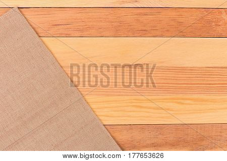 Fabric on wooden table. Soft brown woven linen fabric texture / white wood texture background.