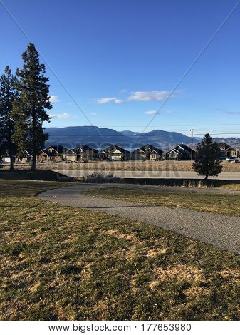 Paved Park Trail With Scenic Background
