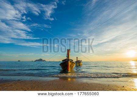 Traditional long tail boat at sunset in Ao Nang Krabi Thailand