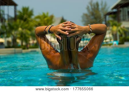 Woman standing in the swimming pool
