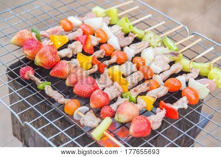 meat and vegatable barbeque wih strawberry on the grill