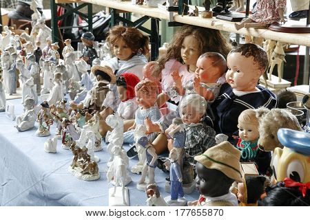 Montreux Switzerland - May 25 2013: Dolls those smaller and larger and made of various materials were put on sale at the famous Covered Market. These objects are exhibited at the flea market.