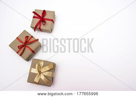Three small gift boxes on a white background