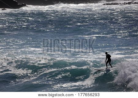 Stock photo of a surfer in the ocean