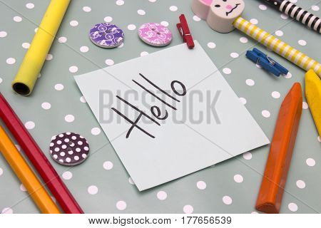 A sticker with an inscription hello on background polka dots