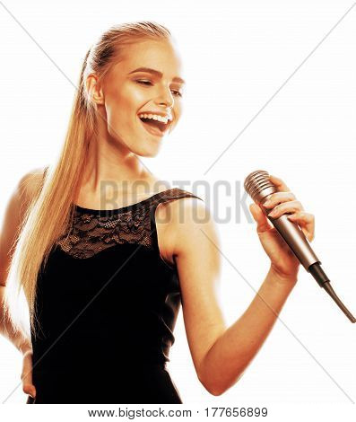 young pretty blond woman singing in microphone isolated close up karaoke singer