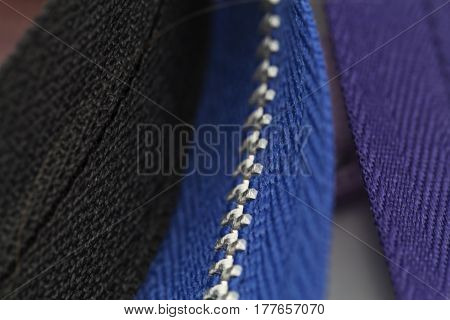 A standard zipper for clothing in macro detail