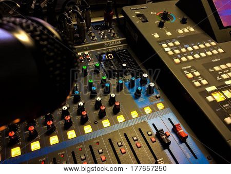 Stage lighting control panel for light technician to work at concert in night club.Scene lights controller mixer panel.Professional nightclub music show equipment editorial