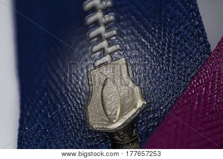 A standard zipper for clothing in macro detail with an artistic flare