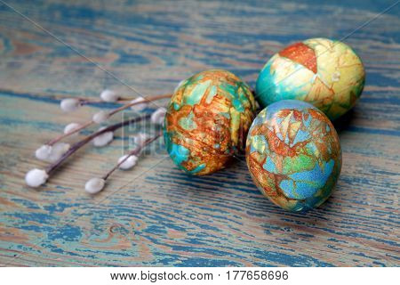 Colorful easter egg willow twigs on wood background