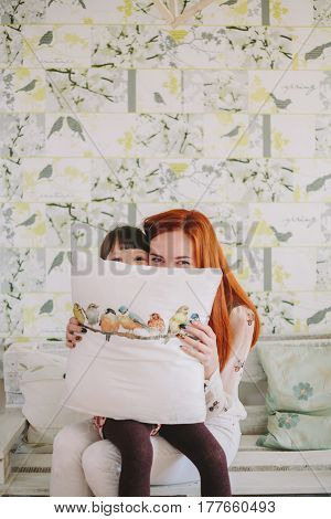 mother and daughter hid under the pillow.